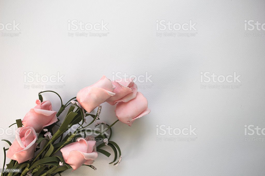 Pink roses on watercolor paper stock photo