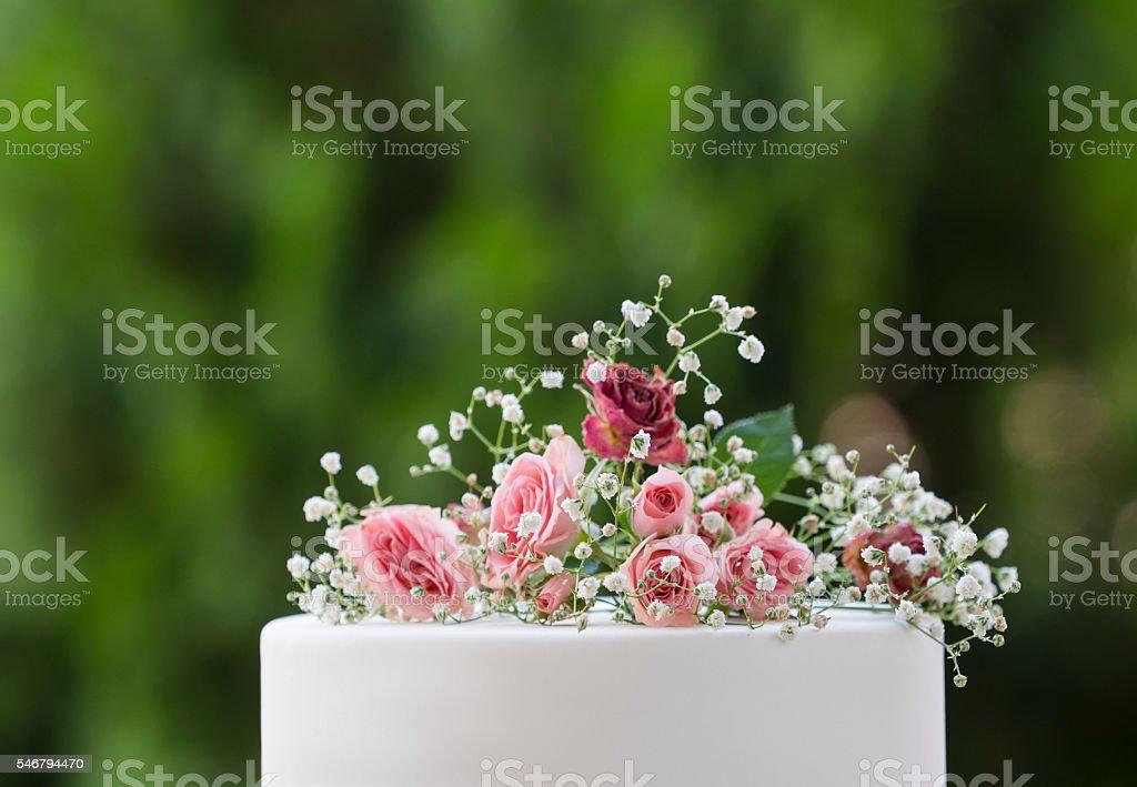 Pink roses on wedding cake stock photo