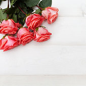 istock Pink roses on white wooden background. Floral frame, Mothers day, st. Valentines day roses, Bouquet of pink roses, Floral background image with copy space for text 1193507524