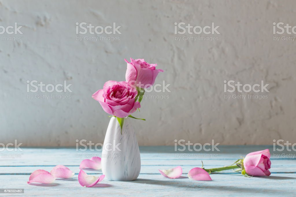 pink roses on wooden table stock photo