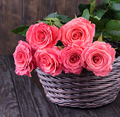 istock Pink roses over wooden table. Valentines day background. 1205793376