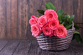 istock Pink roses over wooden table. Valentines day background. 1205793382