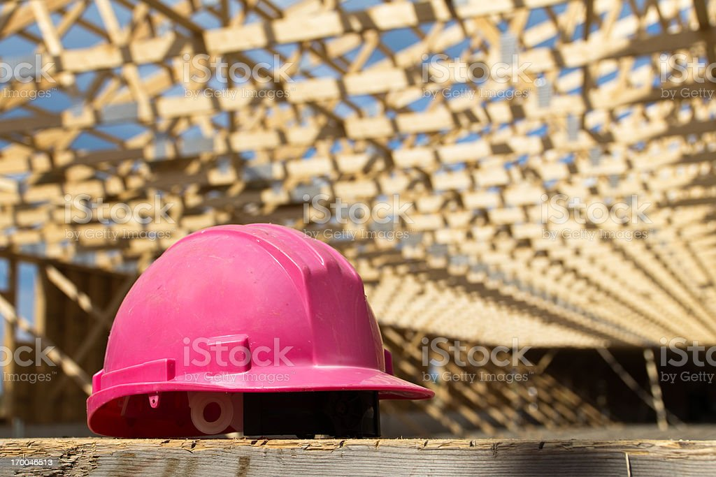 Pink Safety Hat on Construction Site royalty-free stock photo