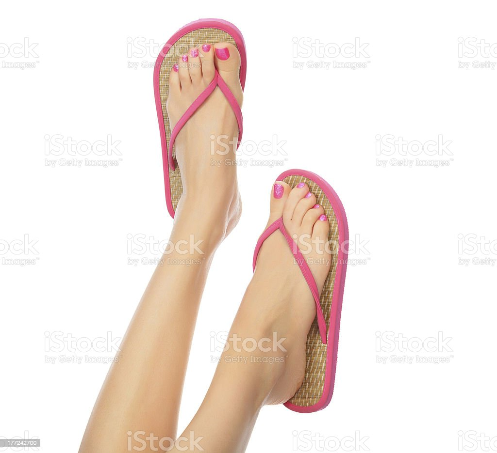 pink sandals on female feet stock photo