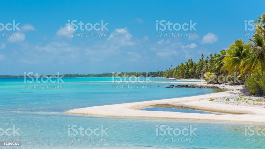 Pink sandy beach in French Polynesia stock photo