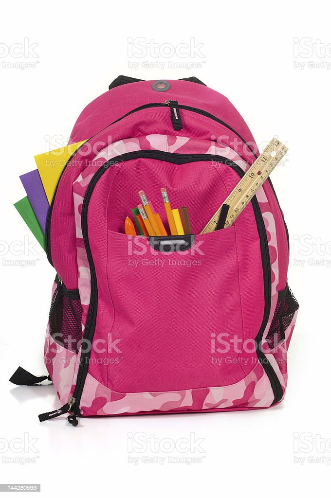 Pink school backpack with supplies royalty-free stock photo