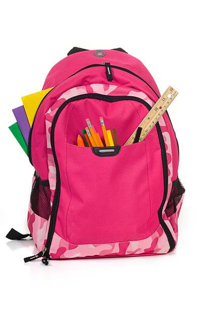 pink packback mit schulsachen - rosa tarnfarbe stock-fotos und bilder