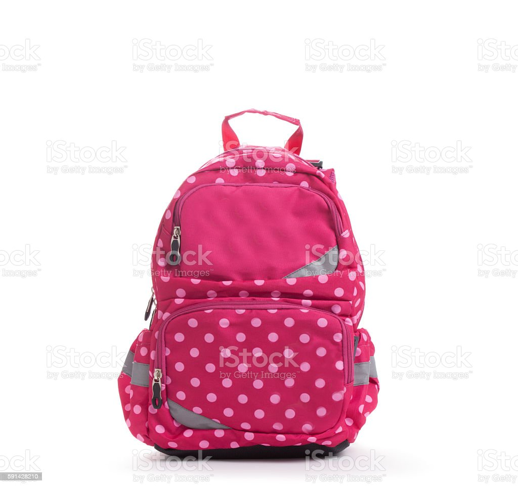 Pink school backpack with white dots isolated on white стоковое фото