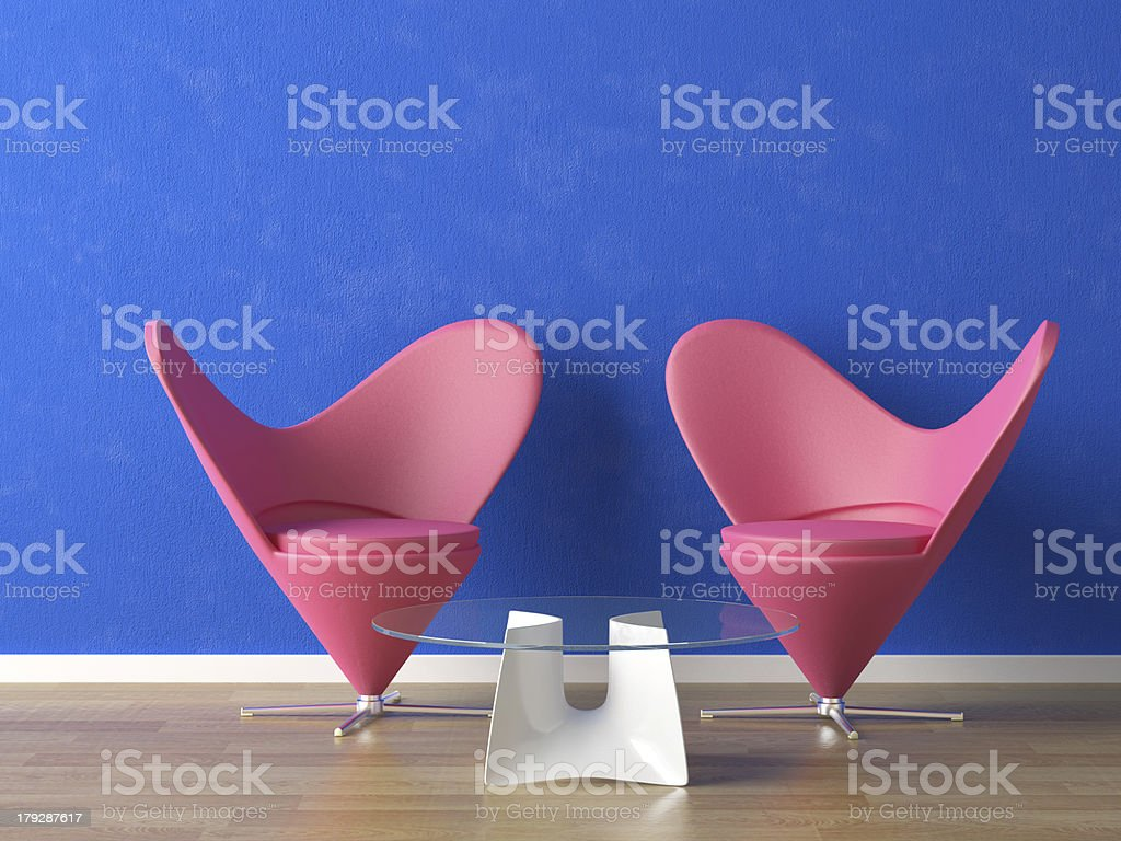 pink seats on blue wall royalty-free stock photo