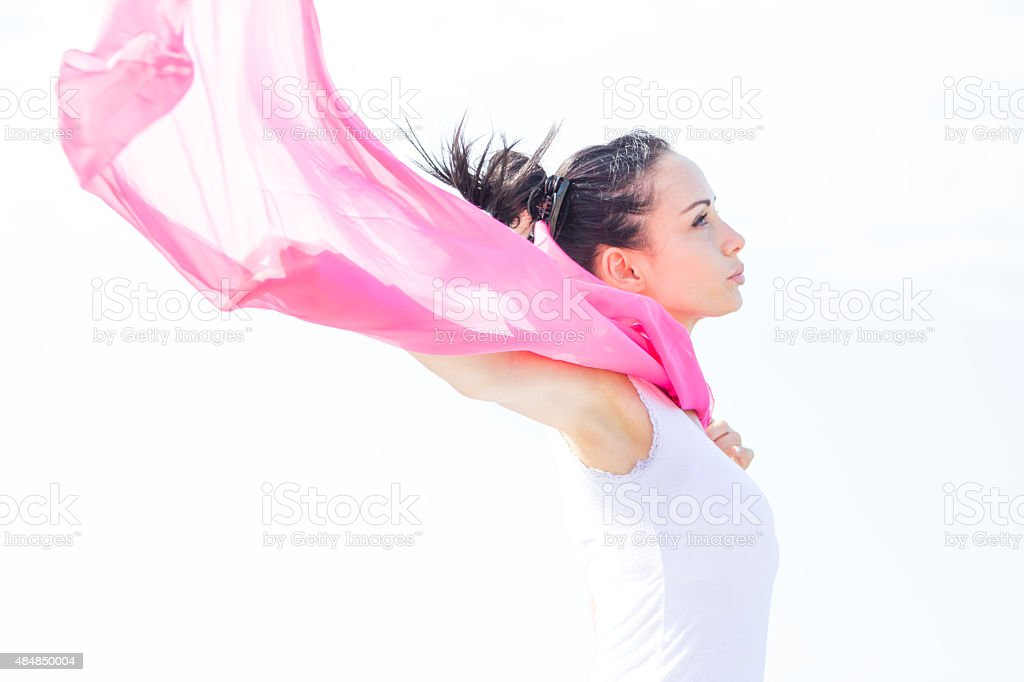 pink shawl in the wind stock photo