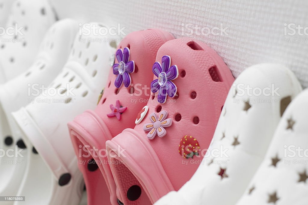 Pink shoes among white ones. royalty-free stock photo
