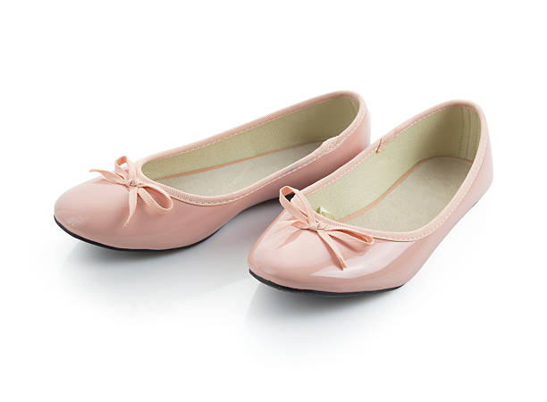 pink shoes with ribbons - flat shoe stock pictures, royalty-free photos & images