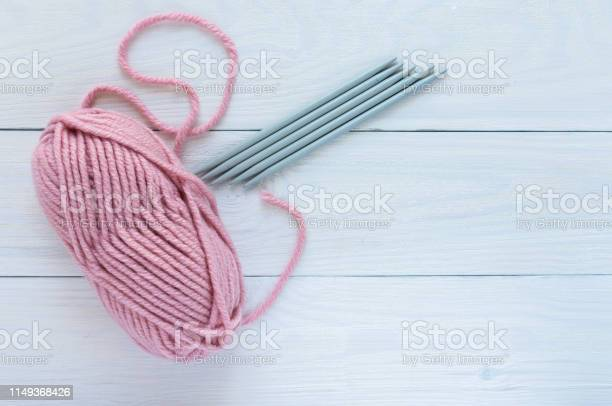 Pink skein with knitting needles picture id1149368426?b=1&k=6&m=1149368426&s=612x612&h=cjoxvprhr2ikupbiims4l nkizy2bhbwpin19dezvyy=