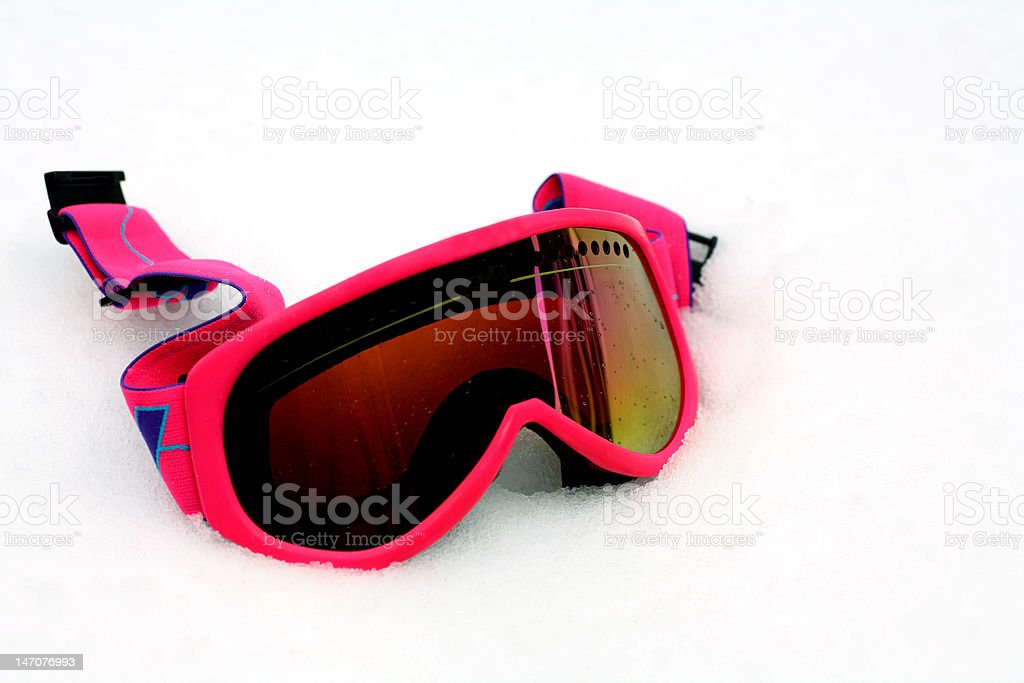 Pink Ski Goggles in Snow stock photo