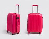 Pink small luggage bag side and front view isolated on white background