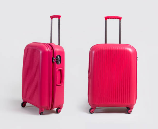 pink small luggage bag side and front view isolated on white - bagaglio foto e immagini stock