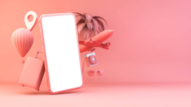 Pink smartphone with travel objects stock photo