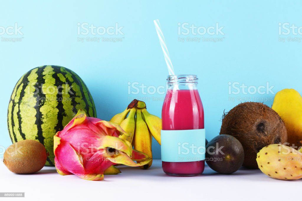 Pink smoothie with tropical fruits. stock photo