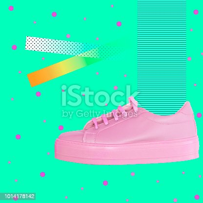 istock pink sneaker on geometric background with lines and dots. 1014178142