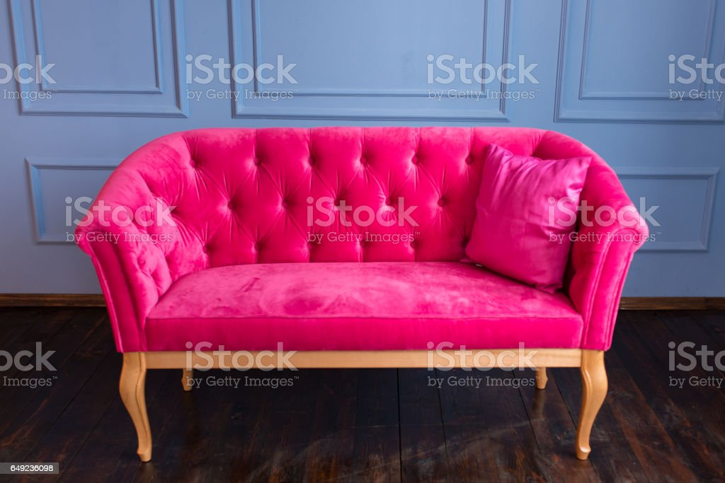 Pink Sofa On A Blue Wall Background stock photo 649236098 | iStock
