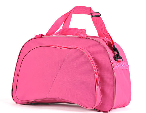 A pink sport bag on a white background stock photo