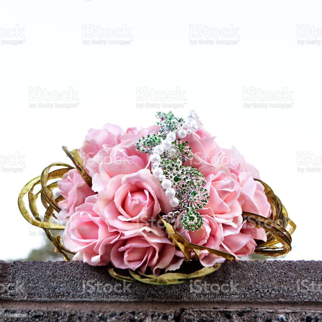 Pink spring bouquet of roses on a wedding day in square comosition stock photo