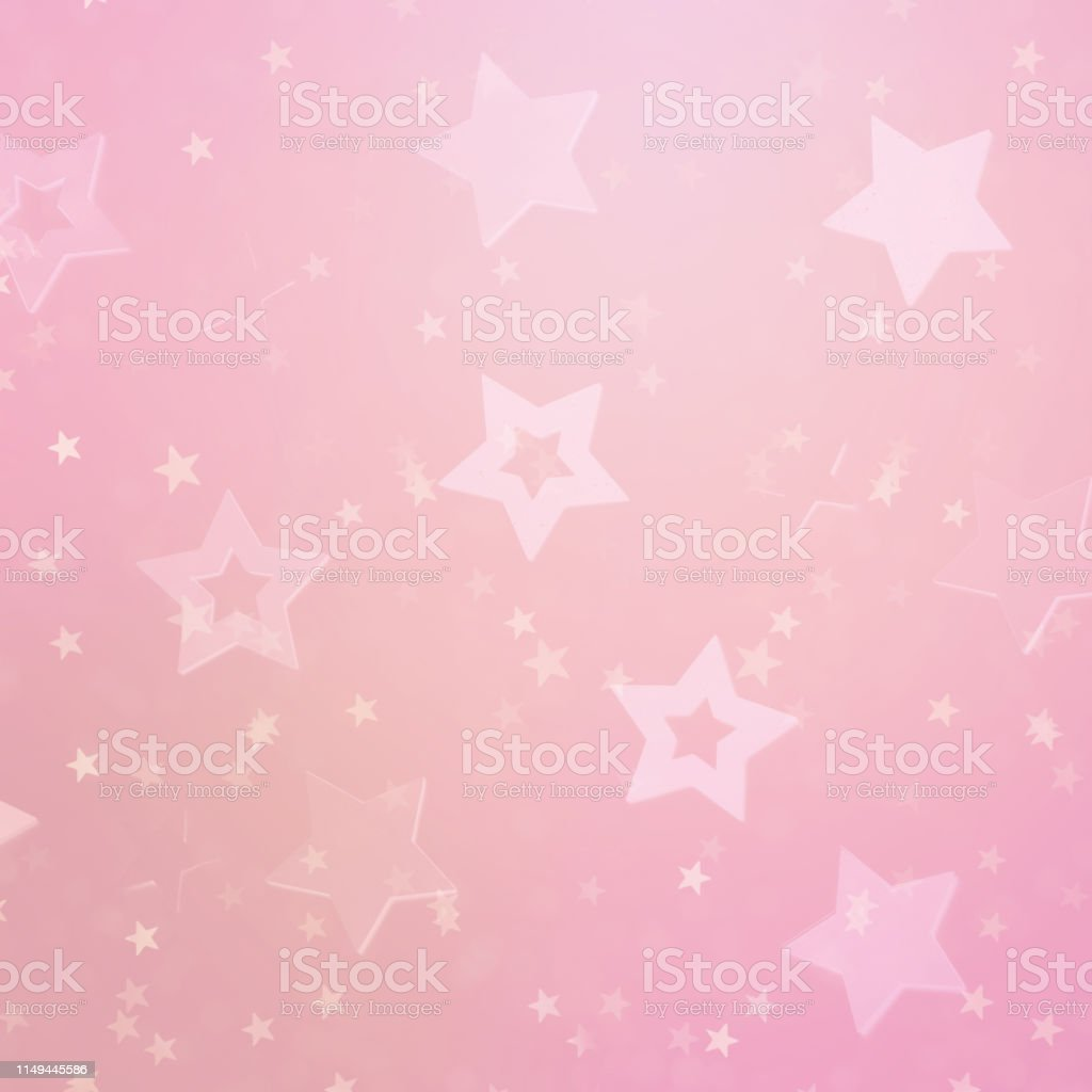 Pink stars on gold background with bokeh. Texture for new year,...