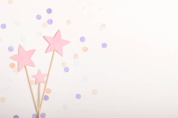 Pink stars on stick topping on white background with confetti pastel picture id1060591598?b=1&k=6&m=1060591598&s=612x612&w=0&h=wtc79 zygvqfaatroyiwj5g0678cs jmvnjw4rovvw0=
