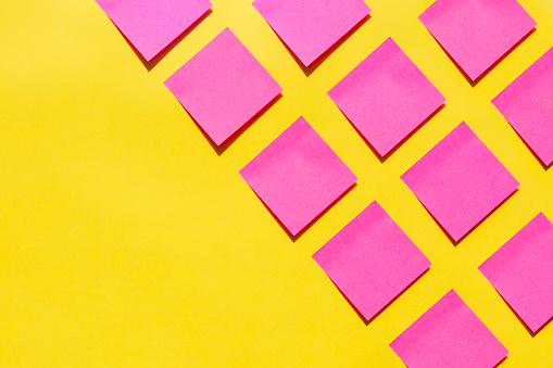 Pink sticky notes on yellow background