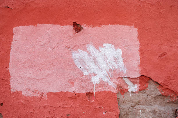 Pink stucco on an old wall with strokes of white paint stock photo