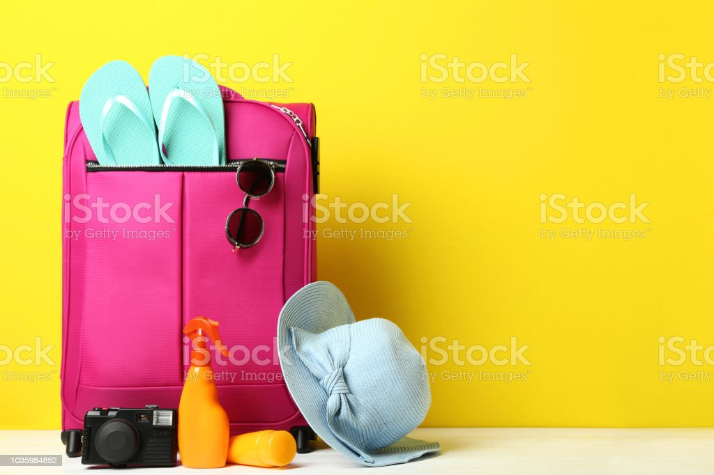 bec05cd6b15e1 Pink Suitcase With Flipflops Hat Sunglasses And Sunscreen Bottles On ...