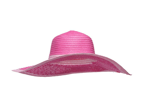 Pink sun hat on white background stock photo