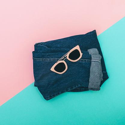 640200626 istock photo pink sunglasses on jeans 640200896