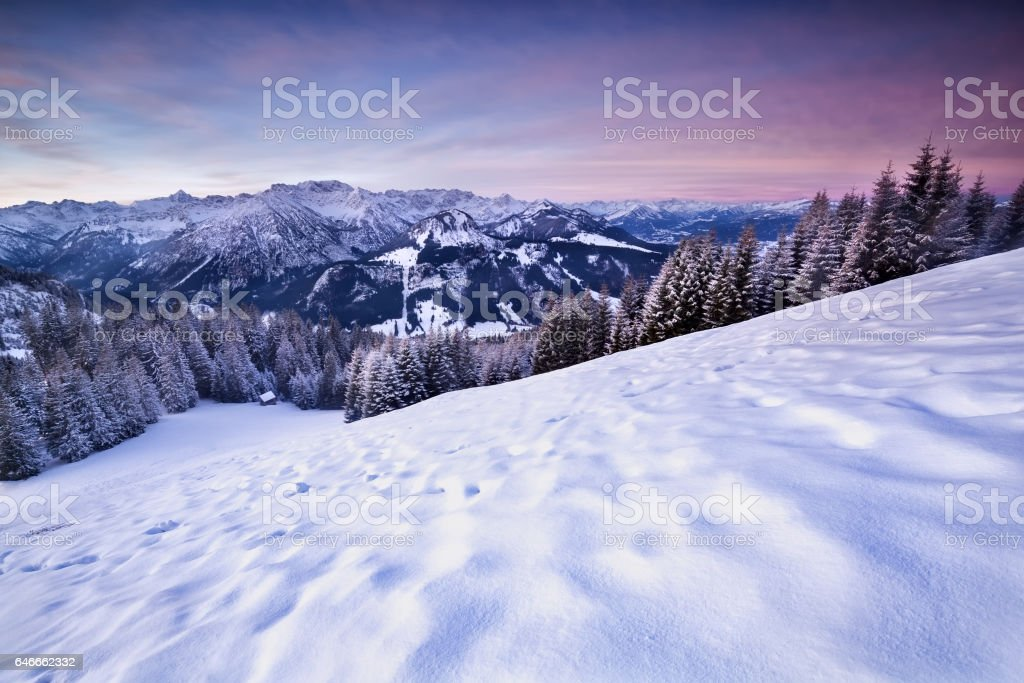 pink sunrise in winter Alps stock photo