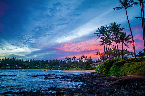 pink sunrise, napili bay, maui, hawaii stock photo