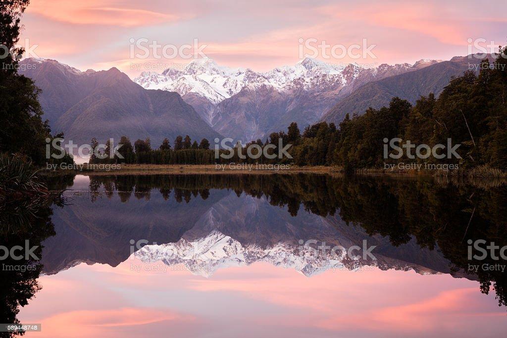 Pink sunrise over Lake Matheson, South Island, New Zealand stock photo