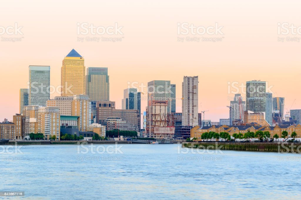 Pink sunset at Canary Wharf in London stock photo