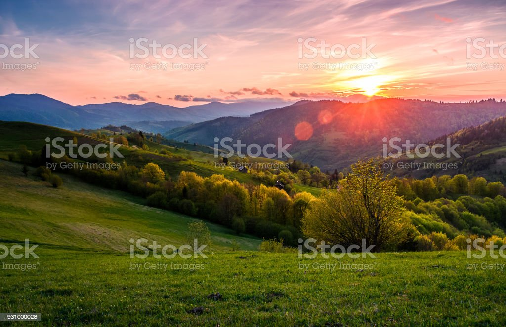 pink sunset over the mountains in springtime stock photo