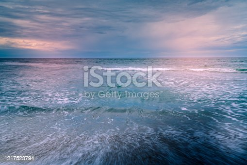 528963376 istock photo Pink sunset over the sea. Abstract seascape background 1217523794