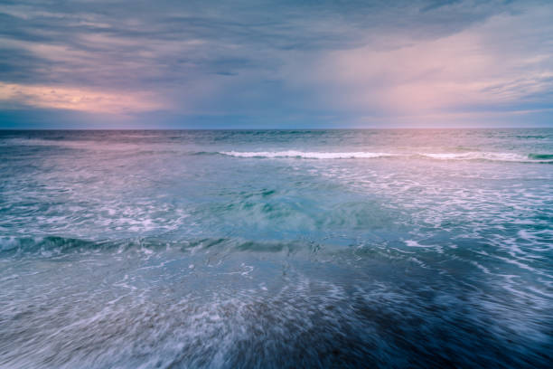 Pink sunset over the sea. Abstract seascape background stock photo