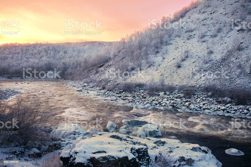 Pink sunset over winter mountain river royalty-free stock photo