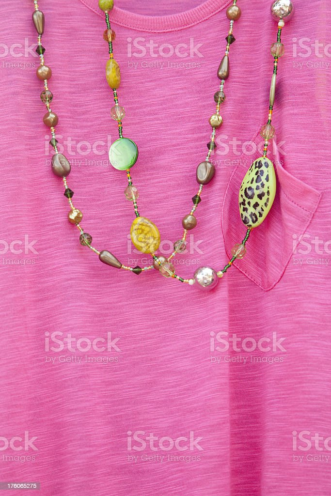 Pink Sweater with Two Beaded Necklaces, Fashion Apparel royalty-free stock photo