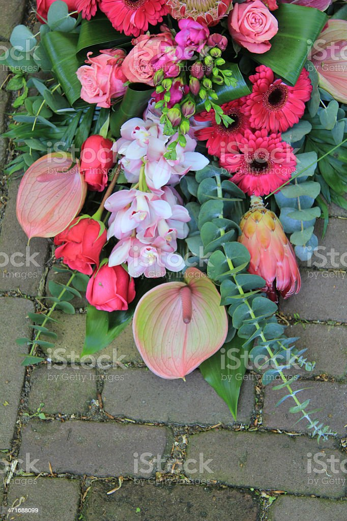pink sympathy bouquet on pavement royalty-free stock photo