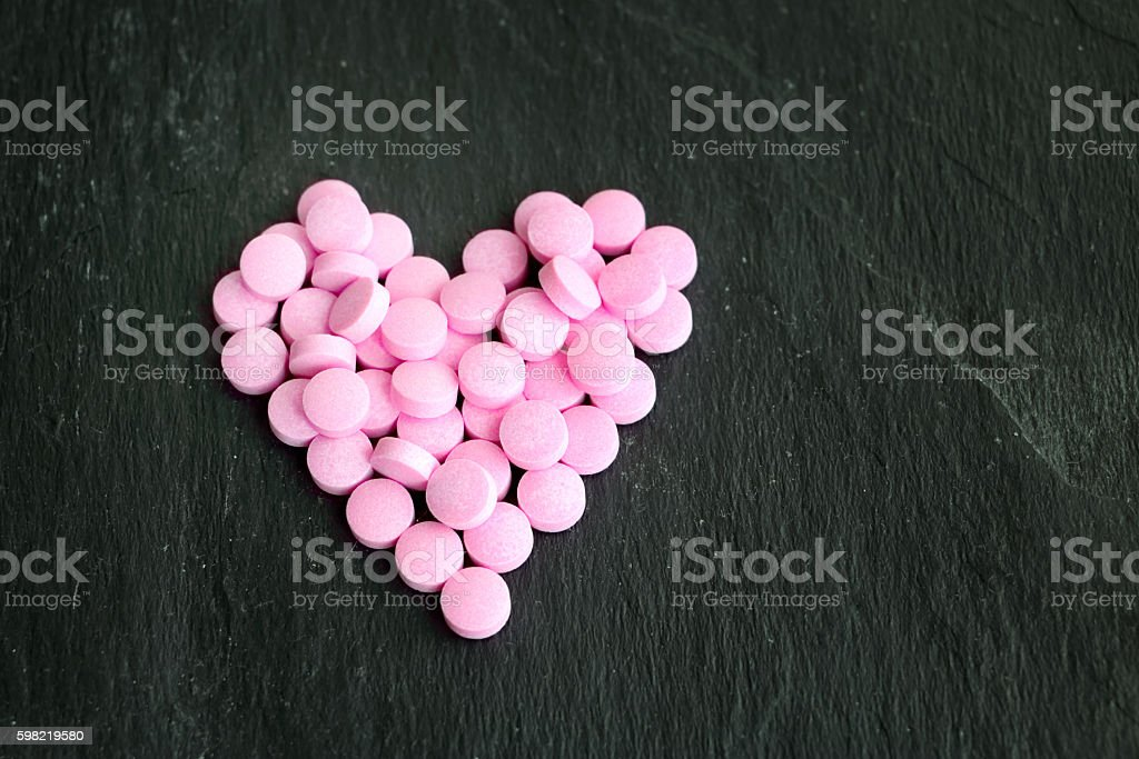 Pink tablets arranged in heartlet foto royalty-free