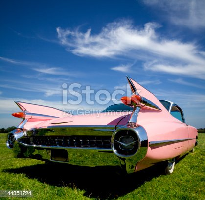 The classic pink 1959 Cadillac Coupe de Ville with her tail up.