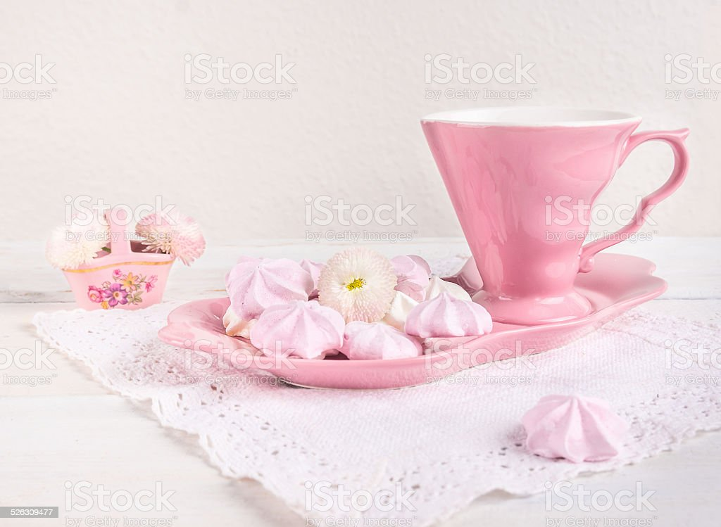 pink tea set with cookies on a white background stock photo