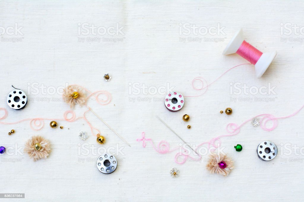 pink theme needle and thread for handicraft background stock photo