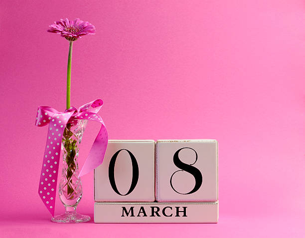 pink theme save the date for international women's day - womens day stock photos and pictures