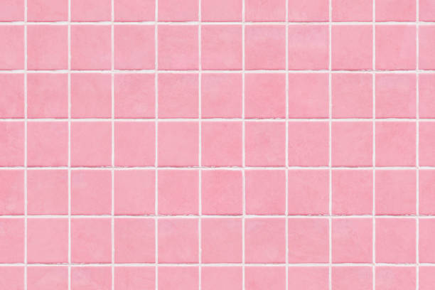ピンク色のタイル壁のテクスチャ背景 - タイル ストックフォトと画像
