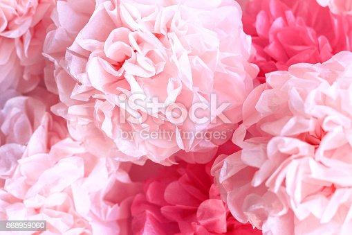 istock Pink Tissue Paper Pom Poms Background 868959060